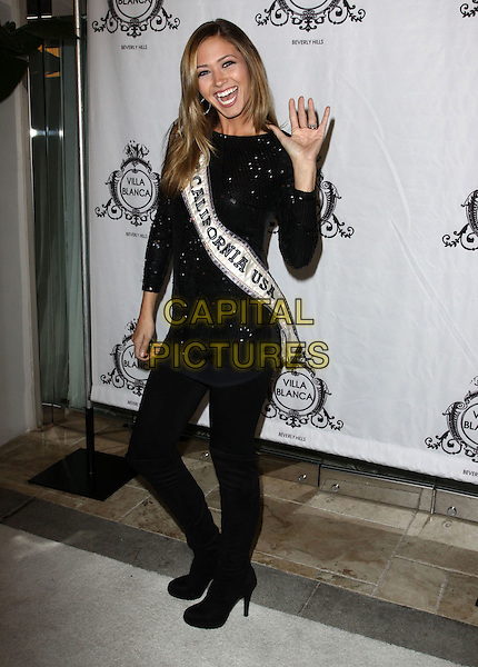 "TAMI FARRELL - Miss California 2009.Attending the  ""America's Next Top Model"" party at Villa Blanca, Beverly Hills, California, USA, .17th November 2009. .full length sash black sequined sequin dress tights knee high boots hand  waving mouth open funny  smiling .CAP/ADM/KB.©Kevan Brooks/AdMedia/Capital Pictures."