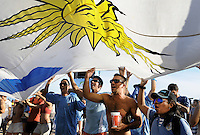 Uruguay soccer fans react during the 2014 World Cup soccer game between Uruguay against Costa Rica inside the FIFA Fan fest area on Copacabana beach, Rio de Janeiro, Brazil, June 14, 2014