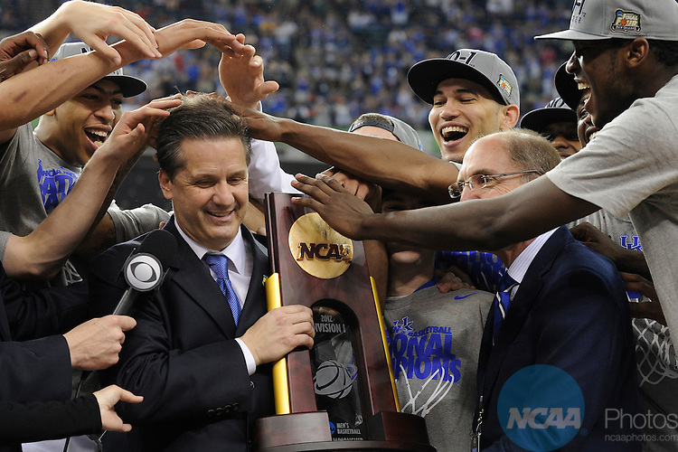 02 APR 2012: Head Coach John Calipari, Anthony Davis and the rest of players from the University of Kentucky celebrate with the championship trophy following the Championship Game of the 2012 NCAA Men's Division I Basketball Championship Final Four held at the Mercedes-Benz Superdome hosted by Tulane University in New Orleans, LA. Kentucky defeated Kansas 67-59 to claim the championship title. Ryan McKee/ NCAA Photos.