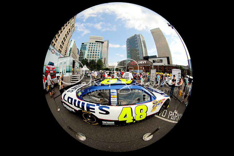 Photography of the 20010 Speed Street festival in downtown Charlotte, NC. Event organizers shut down sections of the Charlotte Center City for the 16th annual family-friendly event, which includes music, NASCAR show car appearances, autographs from NASCAR drivers, games, food and fun. Key sponsors include Food Lion, Coca-Cola, Miller Lite and Chevrolet. Photos by Charlotte photographer Patrick Schneider of Patrick Schneider Photography. Food Lion Speed Street runs in conjunction with the Coca-Cola Classic 600 NASCAR race at the Charlotte Motor Speedway in nearby Concord, NC.