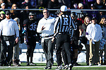SIOUX FALLS, SD, NOVEMBER 26:  Head Coach Jed Stugart from the University of Sioux Falls gets an explanation from an official on a penalty against Harding University Saturday afternoon at Bob Young Field in Sioux Falls. (Photo by Dave Eggen/Inertia)