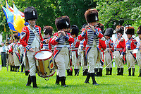 "Drummer and fifers of the Second Company, Governor's Foot Guard Field Music Unit, New Haven, Connecticut, march on Norwichtown Green in celebration of Samuel Huntington's birthday. Arguably the first president of the USA,  Huntington was president of Congress when the nation was first designated ""United States"" in the Articles of Confederation."