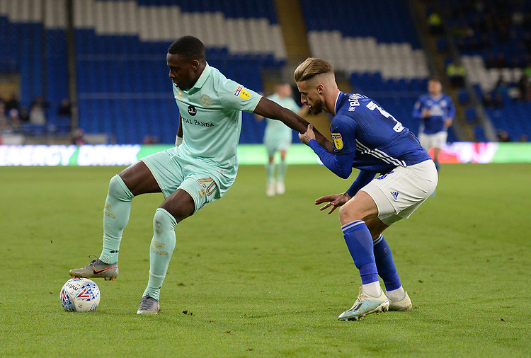 Queens Park Rangers' Bright Osayi-Samuel shields the ball from Cardiff City's Joe Bennett<br /> <br /> Photographer Ian Cook/CameraSport<br /> <br /> The EFL Sky Bet Championship - Cardiff City v Queens Park Rangers - Wednesday 2nd October 2019  - Cardiff City Stadium - Cardiff<br /> <br /> World Copyright © 2019 CameraSport. All rights reserved. 43 Linden Ave. Countesthorpe. Leicester. England. LE8 5PG - Tel: +44 (0) 116 277 4147 - admin@camerasport.com - www.camerasport.com