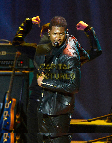 "19 January 2013 - Washington D.C, District of Columbia - Usher Raymond. ""Kids' Inaugural: Our Children. Our Future at the Washington Convention Center. .on stage in concert live gig performance performing music half length black leather jacket side singing .CAP/ADM/CNP/RS.©Ron Sachs/CNP/AdMedia/Capital Pictures."