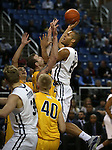 Nevada's Robyn Missa drives into a crowd during a college basketball game against  Northwest Christian in Reno, Nev., on Sunday, Dec. 28, 2014. Nevada won 81-67.<br /> Photo by Cathleen Allison