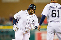 Prince Fielder (28) of the Detroit Tigers is greeted by third base coach Tom Brookens (61) as he rounds third base after hitting a home run against the Tampa Bay Rays at Comerica Park on June 4, 2013 in Detroit, Michigan.  The Tigers defeated the Rays 10-1.  Brian Westerholt/Four Seam Images