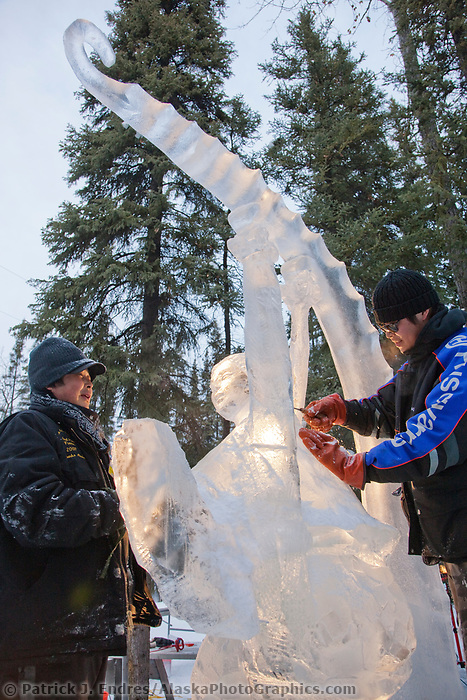 "Single block, realistic sculpture titled ""Invitation"" by An, Di An, Qi Feng from China, during the 2009 World Ice Art Championships in Fairbanks, Alaska."