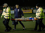 Lewis Macleod stretchered off after suffering injury as physio Stevie Walker looks after him