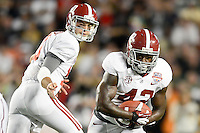 January 7, 2013: Alabama quarterback AJ McCarron (10) hands the ball off to Alabama running back Eddie Lacy (42) during 1st half of the Discover BCS National Championship game between the Alabama Crimson Tide and the Notre Dame Fighting Irish at Sun Life Stadium in Miami Gardens, Fl