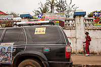 Political posters are places on buildings, walls, and vehicles near a political rally in Monrovia, Liberia.