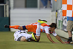 27 May 2015: Carolina's Wells Thompson (above) and Charlotte's Tomasz Zahorski (below) tumble out of bounds after challenging for the all. The Carolina RailHawks hosted the Charlotte Independence at WakeMed Stadium in Cary, North Carolina in a 2015 Lamar J. Hunt United States Open Cup Third Round match. Charlotte won the game 1-0.