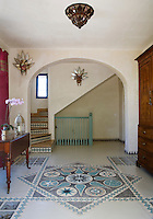A turquoise and grey mosaic decorates the hall floor of the Casita