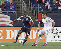 New England Revolution defender Jose Goncalves (23) works to clear ball as Real Salt Lake forward Devon Sandoval (49) pressures.