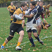 Will Smith of the Buffalo Rugby Club grabs Gene Pearl of the Rochester Rugby Club by the throat as he attempts to score for the Buffalo Rugby Club.