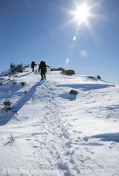 Appalachian Trail - Hikers make their way along the Franconia Ridge Trail in the White Mountains, New Hampshire USA during the winter months.