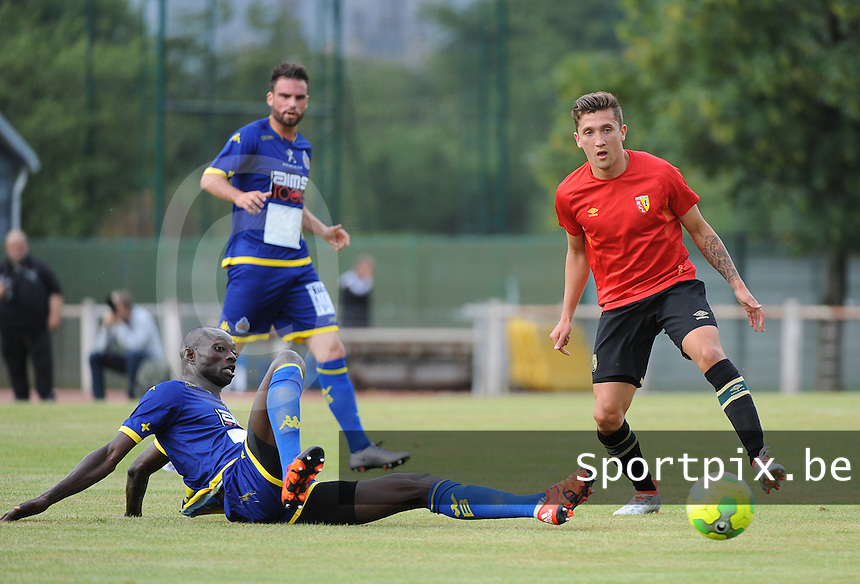 20160713 - DOUAI , FRANCE : RC Lens' Mathias Autret (R) and Waasland Beveren's Ibrahima Seck (down) pictured during a friendly game between Racing Club de LENS and Waasland Beveren during the preparations for the 2016-2017 season , Wednesday 13 July 2016 ,  PHOTO Dirk Vuylsteke | Sportpix.Be