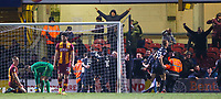 Michael Jacobs of Wigan celebrates with his team mate and wigan fans after scoring in the 90th minute during the Sky Bet League 1 match between Bradford City and Wigan Athletic at the Northern Commercial Stadium, Bradford, England on 14 March 2018. Photo by Thomas Gadd.