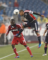 New England Revolution forward Fernando Cardenas (80) heads the ball. Chicago Fire forward Patrick Nyarko (14). In a Major League Soccer (MLS) match, the New England Revolution defeated Chicago Fire, 2-0, at Gillette Stadium on June 2, 2012.
