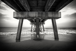 Monochrome photograph of Jacksonville's pier in the late afternoon light.