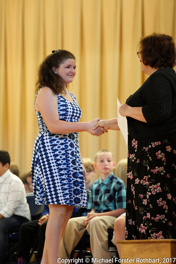 The Oneonta Greater Plains elementary school fifth grade awards ceremony, on June 21, 2017.<br /> &copy; Michael Forster Rothbart Photography<br /> www.mfrphoto.org &bull; 607-267-4893<br /> 34 Spruce St, Oneonta, NY 13820<br /> 86 Three Mile Pond Rd, Vassalboro, ME 04989<br /> info@mfrphoto.org<br /> Photo by: Michael Forster Rothbart<br /> Date:  6/21/2017<br /> File#:  Canon &mdash; Canon EOS 5D Mark III digital camera frame C19162