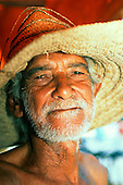 Cachoeiro, Bahia State, Brazil. Man of mixed race (mulato) wearing an old straw hat.