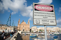Malta, 28 December 2014<br /> <br /> The harbourfront of the Ta Xbiex and Gzira neighbourhoods opposite the old capital of Valetta. The Msida Parish Church.<br /> <br /> Photo Kees Metselaar