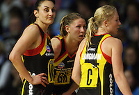 Magic players Joline Henry, Casey Williams and Laura Langman realise the game is out of their reach as the game nears completion during the ANZ Netball Championship match between the Waikato Bay of Plenty Magic and Adelaide Thunderbirds, Mystery Creek Events Centre, Hamilton, New Zealand on Sunday 19 July 2009. Photo: Dave Lintott / lintottphoto.co.nz