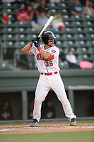 Catcher Kole Cottam (39) of the Greenville Drive bats in a game against the Hickory Crawdads on Wednesday, May 15, 2019, at Fluor Field at the West End in Greenville, South Carolina. Greenville won, 6-5. (Tom Priddy/Four Seam Images)