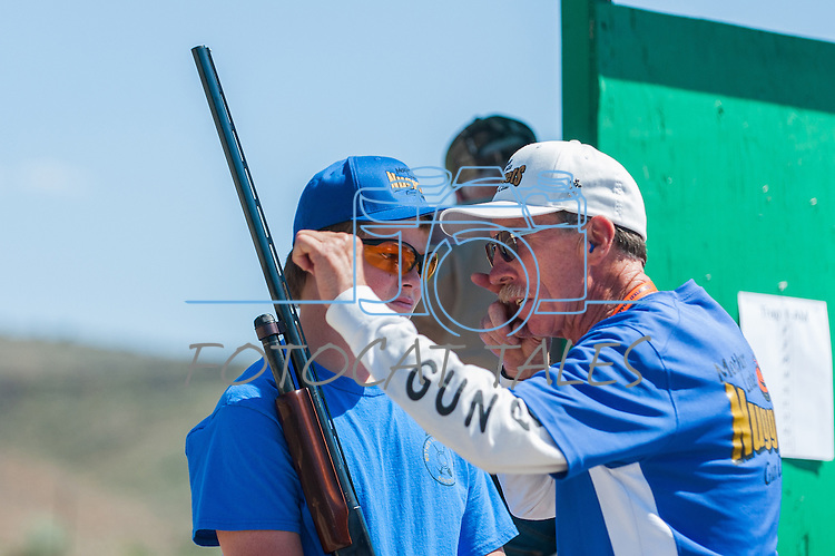 Jonh Luckie, coach for Mother Lode Gun Club, gives advice to Tristan Hagstrom, 14, during the California Youth Shotgun Shooting Association&rsquo;s championship shootout at the Capitol City Gun Club in Carson City, Nev. on Saturday, May 2, 2015.<br /> Photo by Kevin Clifford/Nevada Photo Source