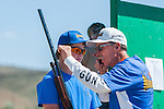 Jonh Luckie, coach for Mother Lode Gun Club, gives advice to Tristan Hagstrom, 14, during the California Youth Shotgun Shooting Association's championship shootout at the Capitol City Gun Club in Carson City, Nev. on Saturday, May 2, 2015.<br /> Photo by Kevin Clifford/Nevada Photo Source