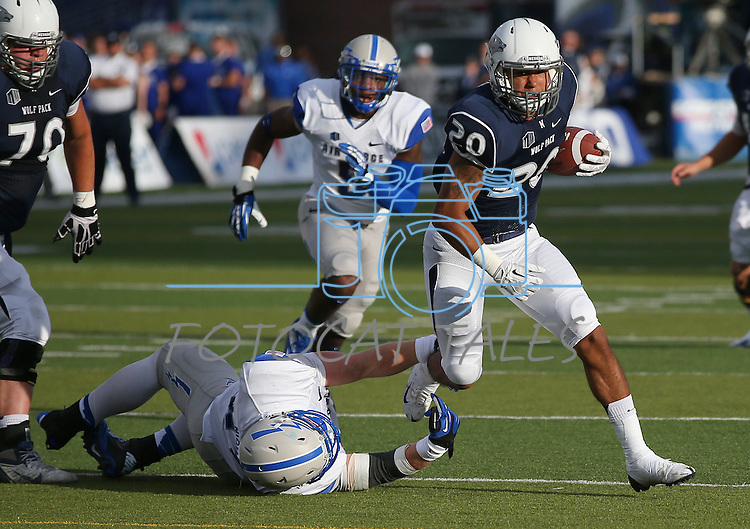 Nevada's Chris Solomon (20) breaks a tackle from Air Force's Joey Nichol (49) during the first half of an NCAA football game in Reno, Nev., on Saturday, Sept. 28, 2013. (AP Photo/Cathleen Allison)