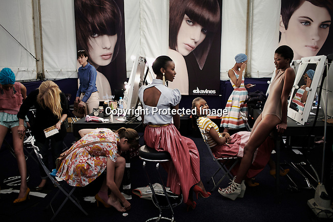 JOHANNESBURG, SOUTH AFRICA SEPTEMBER 22: Models wait backstage before a fashion show at South Africa Fashion Week on September 22, 2011 held in Johannesburg, South Africa. Designers showed their spring/summer collections. (Photo by: Per-Anders Pettersson)