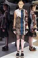 Model in Look 24: Torn Wallpaper Dress
