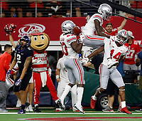 Ohio State Buckeyes wide receiver K.J. Hill (14) celebrates his touchdown catch with Ohio State Buckeyes wide receiver Binjimen Victor (9) against TCU Horned Frogs during the 3rd quarter of their game at AT&T Stadium at Arlington, Texas on September 15, 2018.  [Kyle Robertson/Dispatch]