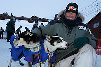 Lachlan Clarke poses with his lead dogs in the finish chute at  Nome on Sunday  March 22, 2015 during Iditarod 2015.  <br /> <br /> (C) Jeff Schultz/SchultzPhoto.com - ALL RIGHTS RESERVED<br />  DUPLICATION  PROHIBITED  WITHOUT  PERMISSION
