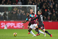 Michail Antonio of West Ham United & Jack Wilshere of Arsenal during the Premier League match between West Ham United and Arsenal at the Olympic Park, London, England on 13 December 2017. Photo by Andy Rowland.