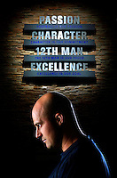Seattle Seahawks quarterback Matt Hasselbeck is shown with a team mission statement that greets visitors in the lobby of the Virginia Mason Athletics Center, the new headquarters of the Seahawks Tuesday, Aug. 26, 2008. (Photo by Andy Rogers)..