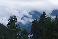 Clouds and mist in the mountains. Deep Cove, Vancouver, BC, Canada