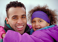 Smiling Father & daughter outdoors in Winter looking at camera. Daughter is in father's arms. parent, child, children, man, family activities, affection, care. J. Keenan & child, M.R. # N-3. outdoors.