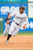 Carlos Sanchez (13) of the Charlotte Knights hustles towards third base against the Gwinnett Braves at Knights Stadium on July 28, 2013 in Fort Mill, South Carolina.  The Knights defeated the Braves 6-1.  (Brian Westerholt/Four Seam Images)