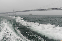 The Onaruto bridge, Naruto, Tokushima Prefecture, Japan, July 8, 2014. The city of Naruto in Tokushima Japan is famous for whirlpools that form in the Naruto Strait. It is home to Otani pottery and the first two temples on the Shikoku 88 temple pilgrimage.