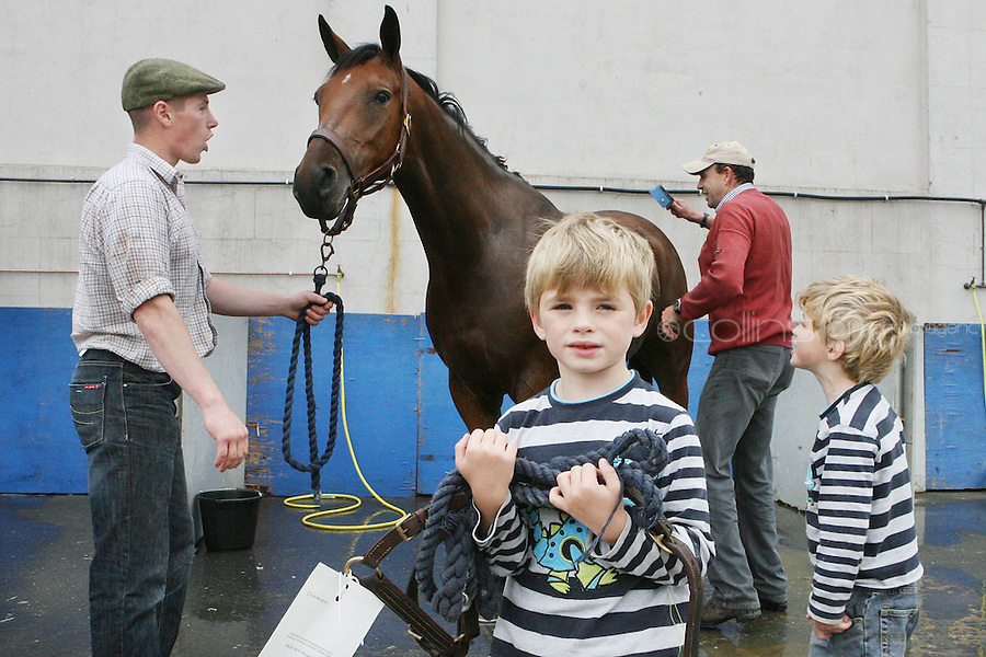 3/8/2010. Twins James and Ivan Ryan Ryan aged 5 from Oldtown Co Dublin are pictured at the RDS with PJ Casey and Kieran Ryan getting their horse Chaperone ready for the start of the Fáilte Ireland Dublin Horse show. Picture James Horan/Collins Photos