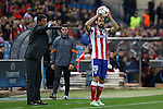 Atletico de Madrid´s Juanfran and Olympiacos´s coach Michel during Champions League soccer match between Atletico de Madrid and Olympiacos at Vicente Calderon stadium in Madrid, Spain. November 26, 2014. (ALTERPHOTOS/Victor Blanco)