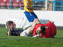 Cowdenbeath keeper Thomas Flynn is caught late by Dundee's Nicky Riley.