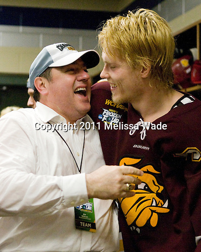 Bill Watson (Duluth - Volunteer Assistant Coach), Mike Montgomery (Duluth - 24) - The University of Minnesota-Duluth Bulldogs celebrated their 2011 D1 National Championship win on Saturday, April 9, 2011, at the Xcel Energy Center in St. Paul, Minnesota.