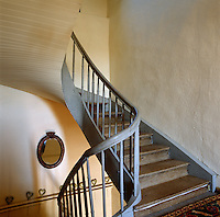 This simple wooden staircase has a lime-washed banister