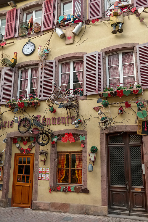 Whimsical decorations add charm to this store front in Colmar.
