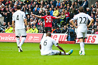 Saturday 17 August 2013<br /> <br /> Pictured: Robin van Persie of Manchester United celebrates after scoring <br /> <br /> Re: Barclays Premier League Swansea City v Manchester United at the Liberty Stadium, Swansea, Wales