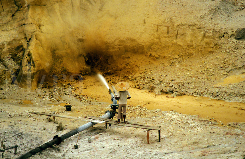 Malaysia.  Hydraulic mining.  Re-mining spoil heaps to recover tin at mine near Ipoh