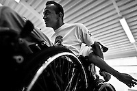 Cristian Amaya, a Colombian disabled athlete, works out during a wheelchair rugby training at Arcangeles gym in Bogota, Colombia, 10 April 2013. Wheelchair rugby, a full-contact team sport, was developed in Canada in 1977 under the name murderball. The game is played only by athletes with some form of disability in both the upper and lower limbs (quadriplegics). Attempting to score by carrying the ball across the goal line, four players from each team roughly crash into each other in specially designed armored wheelchairs. Although the team from Bogota is supported by a foundation (gear), quad rugby players, mostly coming from the remote, socially deprived neighbourhoods, often can not attend a training due to lack of funds for transportation. However, they still dream of representing Colombia at Rio 2016 Paralympic Games.